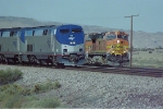 BNSF 4474 waits patiently as The Southwest Chief with AMTK 175 heads east